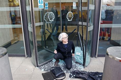 Climate change protesters smash glass and plaster Shell HQ