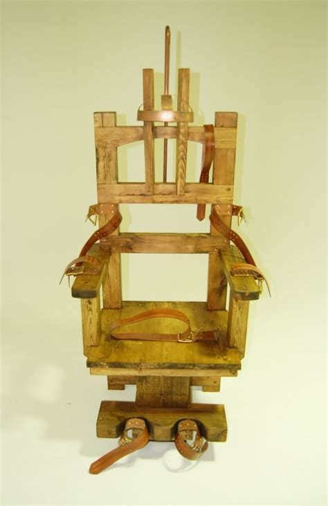 Wooden electric chair with leather restraining straps