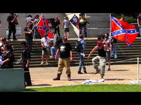 KKK Member Destroy Israeli Flag in State Capital in