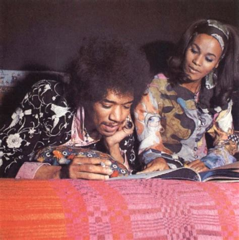 Jimi at home reading with his girlfriend (not sure who she